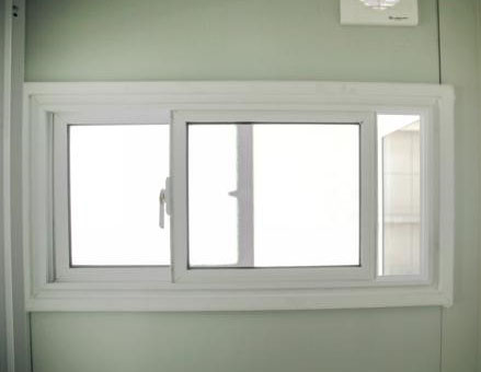 metal container home toilet window
